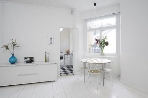 amazing-interior-design-for-small-apartments-in-clean-white-scheme-with-white-black-kitchen-floor-also-table-sink-oven-stove-cabinet-chandelier-window-chair-flower-hardwood-floor