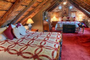 rustic-attic-bedroom-design-with-red-touch