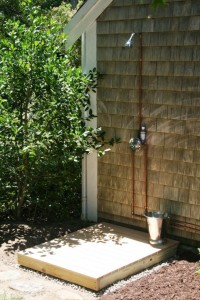 old-farm-outdoor-shower-with-no-wall-overlooking-the-garden-view-and-chrome-bucket-508x761
