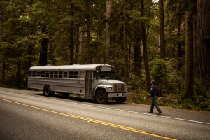 Restored-Bus-Mobile-Home-parked-next-to-the-highway