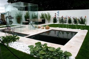exterior-awesome-modern-backyard-decoration-adorable-fish-pond-cool-corner-wicker-furniture-with-brown-cushions-appealing-small-sunroom-with-glasses-green-plants-and-white-pebbles